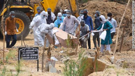 A person who died of Covid-19 is buried at Jadid Qabristan Ahle Islam graveyard, on June 19, in New Delhi, India.