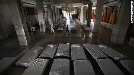 A banquet hall that is normally used for weddings has been converted to makeshift coronavirus hospital as the Indian capital struggles to contain a spike in cases.