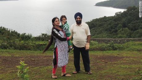 Lakhjeet Singh, 68, tested positive for Covid-19 but couldn't find a hospital to admit him. He is pictured with his daughter and granddaughter.
