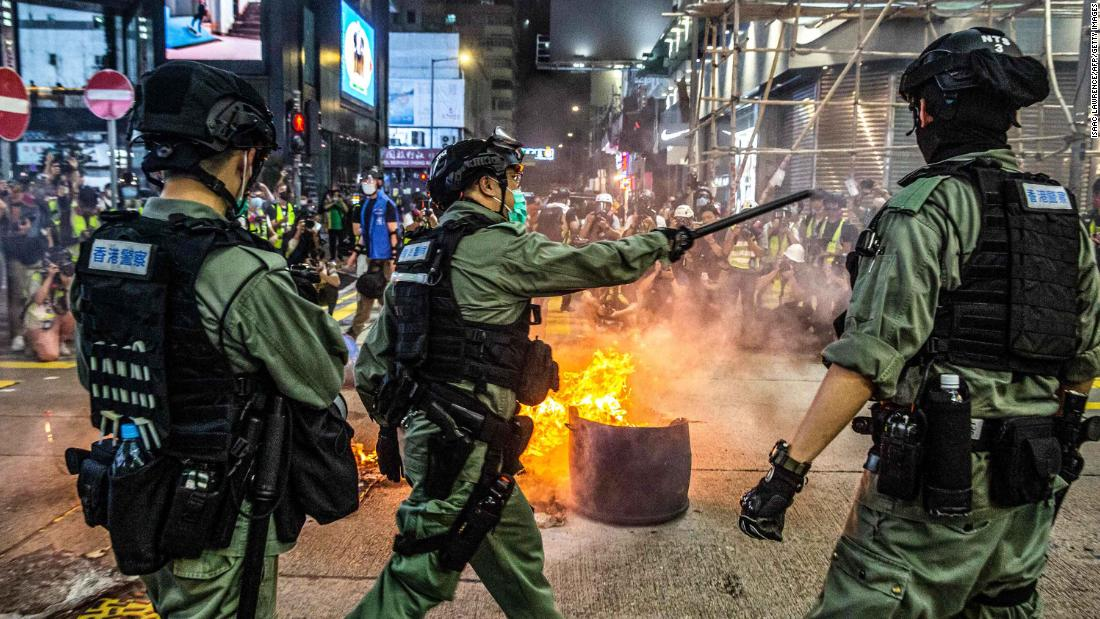 Police stand guard on a road to deter pro-democracy protesters from blocking roads in the Mong Kok district of Hong Kong on May 27, 2020.