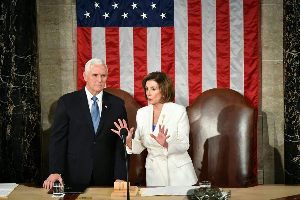 Mike Pence, Pelosi clash over implementing face mask mandate