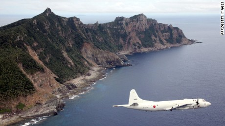 A Japanese military plane flies over the Senakuku/Diaoyu islands in this file photo.