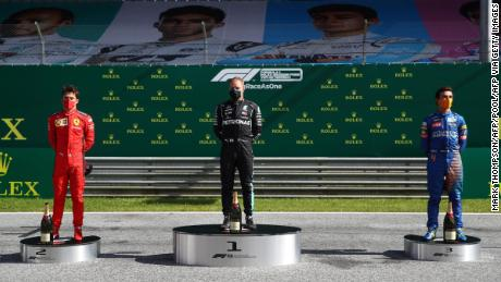 The top three drivers celebrate on the new socially distanced podium.