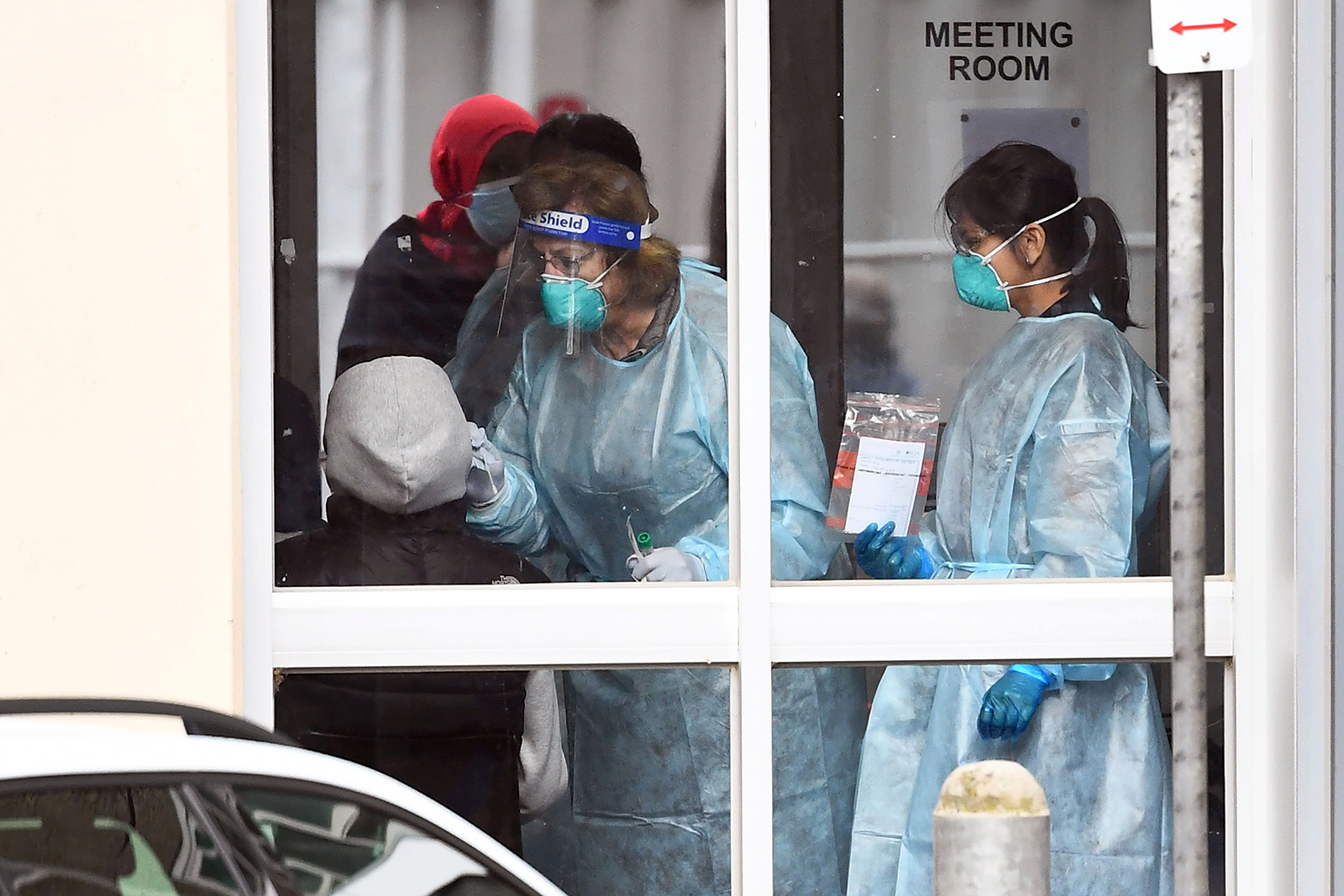 Medical staff perform a Covid-19 test on a resident of one of nine public housing estates locked down due a spike in infection numbers in Melbourne on July 6.
