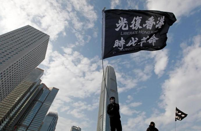 An anti-government protester waves a flag during a protest at Edinburgh Place in Hong Kong, China, January 12, 2020. REUTERS/Navesh Chitrakar/Files