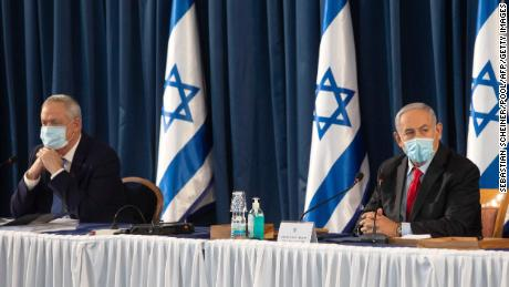 Israeli Prime Minister Benjamin Netanyahu (right) and Defense Minister Benny Gantz attend a weekly cabinet meeting in Jerusalem, on June 14.