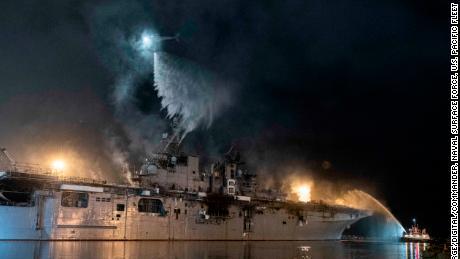 A US Navy helicopter combats a fire aboard the amphibious assault ship USS Bonhomme Richard on July 14.