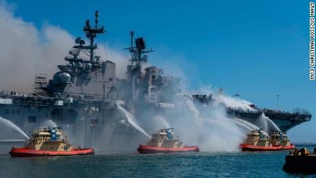 Sailors and federal firefighters combat a fire onboard the amphibious assault ship USS Bonhomme Richard at Naval Base San Diego onJuly 12.