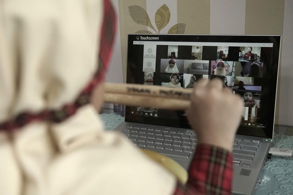 Kindergarten pupils take part on an online class-session amid the coronavirus disease (COVID-19) outbreak in Semarang