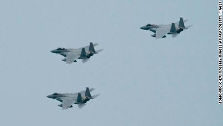 Japan's Air Self-Defense Force's F-15 fighter jets fly during a review after the graduation ceremony of the National Defense Academy on March 22, 2020 in Yokosuka, Japan.
