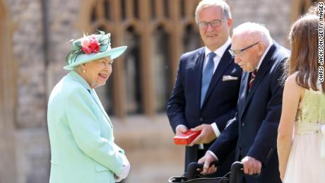 The Queen talks with Moore and his family.