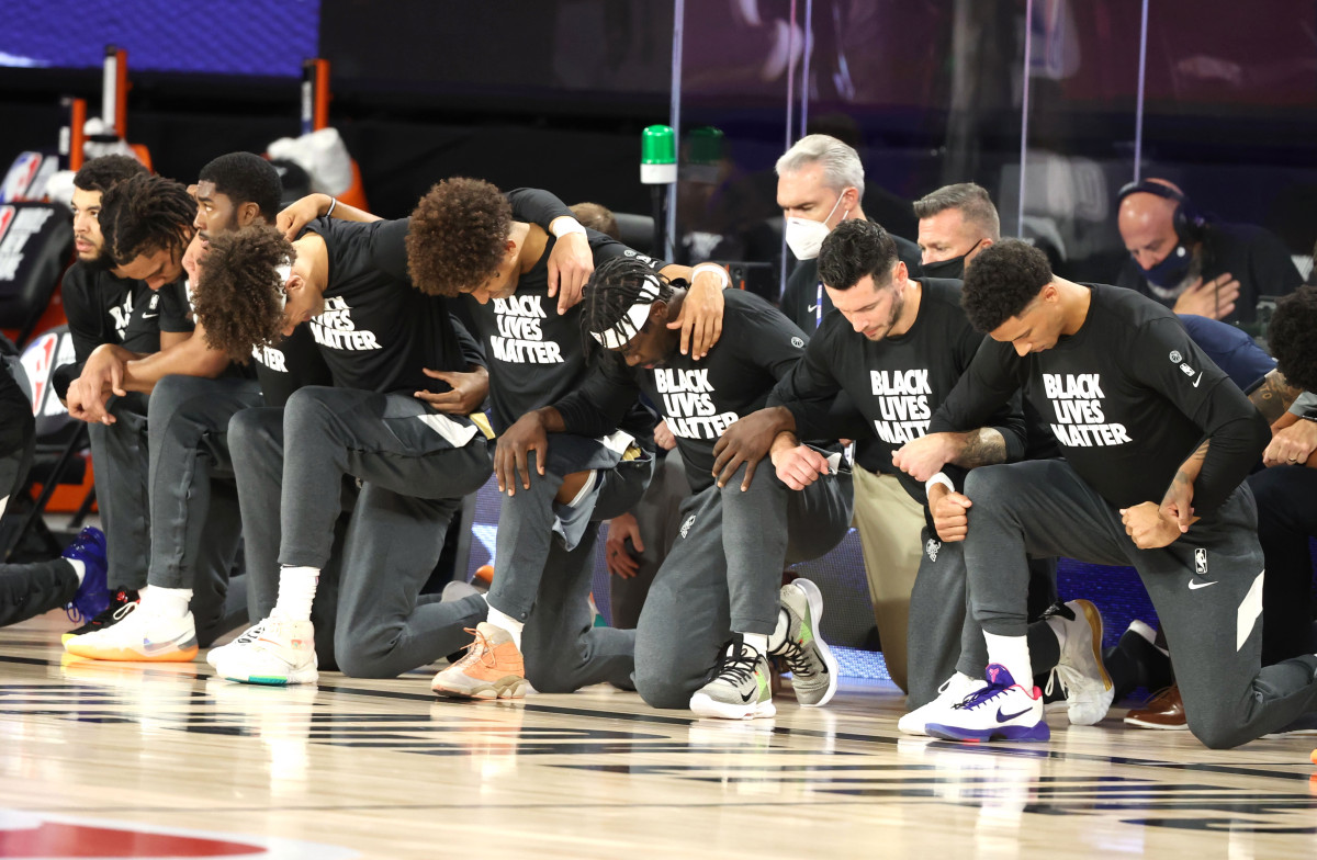 Pelicans and Jazz players, coaches all kneel during national anthem