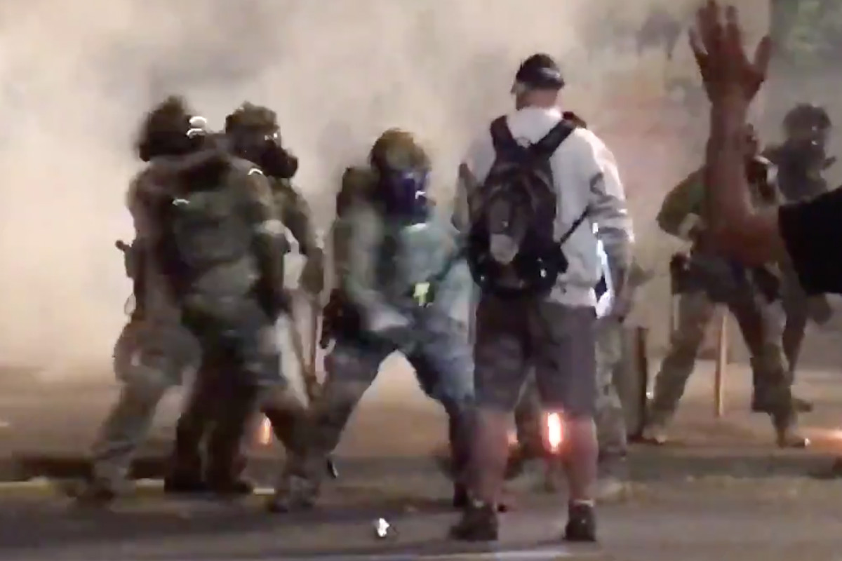 Protester appears unfazed by baton beating, pepper spray in wild video