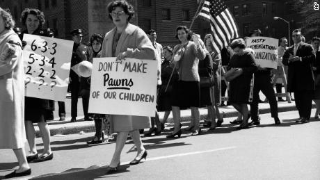 Protests over integrating schools is not new. In 1965 members of a parents' association picketed outside the Board of Education in Brooklyn, New York, against a proposal to integrate public schools.
