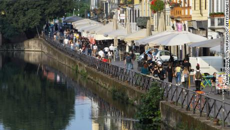 Milan in May. People in Italy are going out for dinner at restaurants, and enjoying the summer tradition of an aperitivo at a local square or bar.