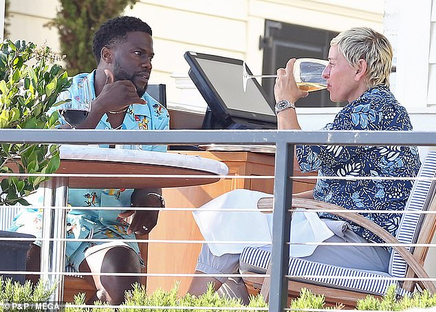 Great listener: While at their table, Ellen slowly sipped on a glass of white wine as Kevin engaged in animated conversation with her