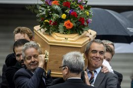 Northern Irish actor James Nesbitt (front, right) carries his father's casket in Coleraine, Northern Ireland, ahead of the funeral of his father, to be held at Downhill Burying Ground