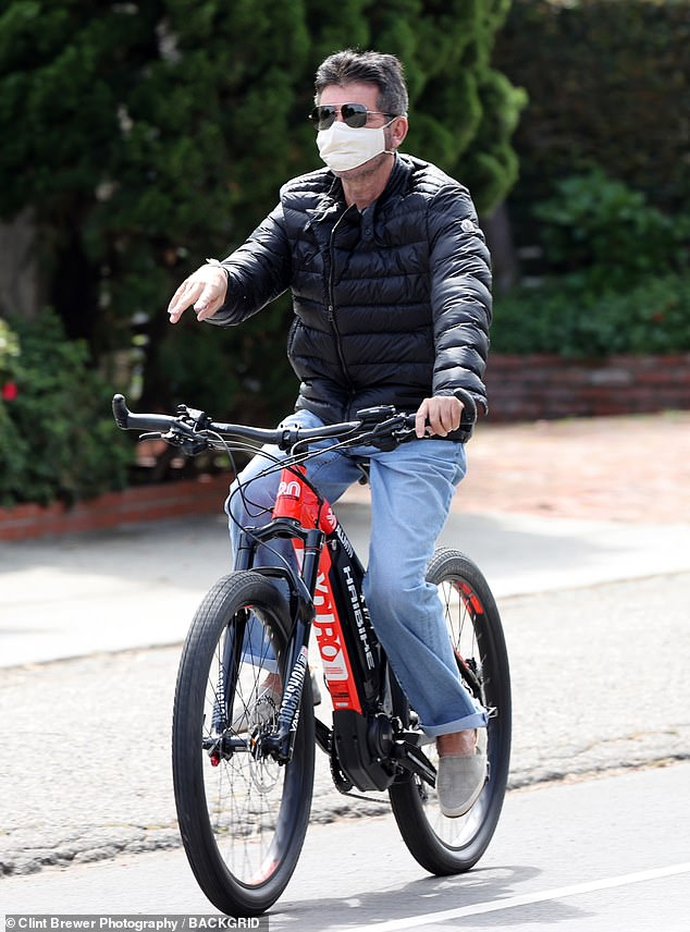 Accident: The star broke his back earlier in August after he fell from his new electric bike while testing it out at his Malibu home (pictured on another bike in April)
