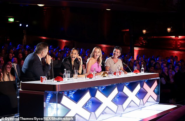 Team: Simon is pictured with talent judges David Walliams, Amanda Holden and Alesha Dixon during an episode of the show which aired in May