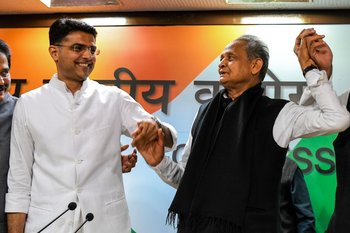 Rajasthan chief minister Ashok Gehlot (R) and his newly-appointed deputy Sachin Pilot