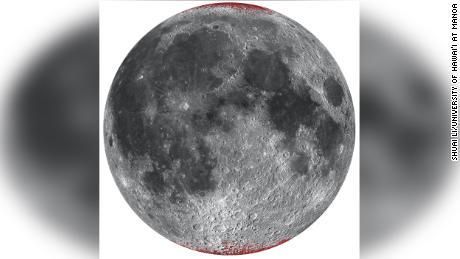 An enhanced map of the hematite (dust) on the Moon is shown in red with a nearby spherical projection.