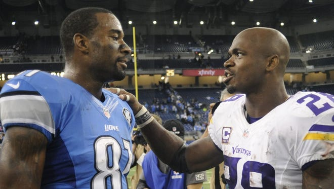 Calvin Johnson, wide receiver for the Detroit Lions, and left Minnesota Viking meet Adrian Peterson on October 25, 2015 after a game in Detroit.
