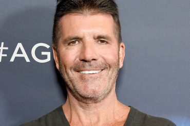 Simon Cowell's brother Tony slaps the star on the cheek for a bad bike accident