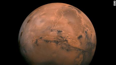 Mars, the fourth planet from the Sun, has days as long as Earth's. But it is a small planet, with an average temperature of -81 degrees Fahrenheit, and its atmosphere is very thin and contains carbon dioxide.