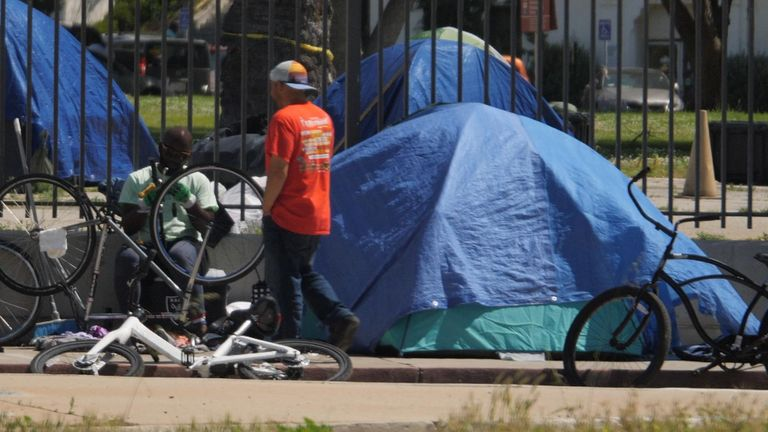 Tents line the streets in the affluent areas of Los Angeles