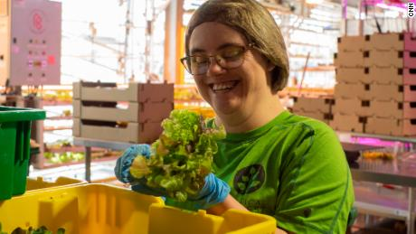 Mika Miller, a vertical harvest worker, delivers spinach greens to one of four grocery stores, Vertical Farm Services in Jackson, Wyoming.
