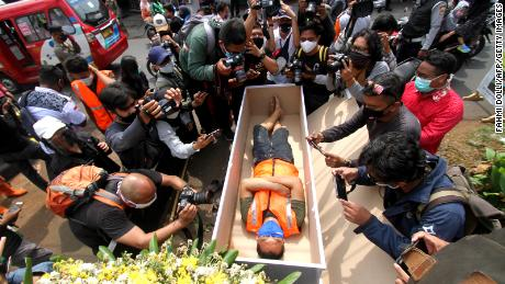 The public and media took pictures as part of the execution of local authorities when a man wearing a mask was caught in a mock coffin in public and was executed by local police in Jakarta on September 3rd.