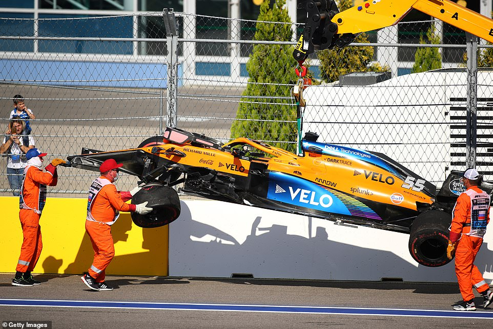 McLaren 's Spanish driver, Carlos Sains, crashed into a barrier that ran wide in the opening lap at the second bend.
