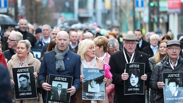 Families of the dead march through the Bogside Estate in London
