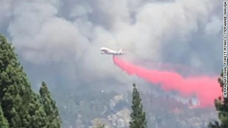 An air tanker fire retardant in a wildfire in the Sierra National Forest.