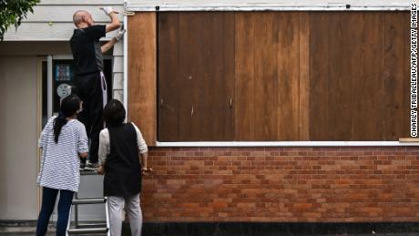 Someone barricades a hair salon before Typhoon Heishen arrives in Makurasaki, Kagoshima Prefecture, on September 5th.