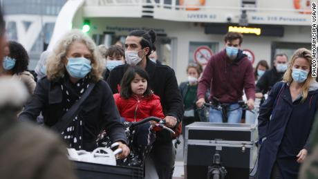 Locals wear masks on a ferry on the IJ River in Amsterdam as face covering is mandatory in the Netherlands.