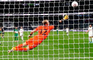 Maccabi Haifa's Tijaron Cherry throws the ball past Tottenham goalkeeper Joe Hart.  Photo: PA