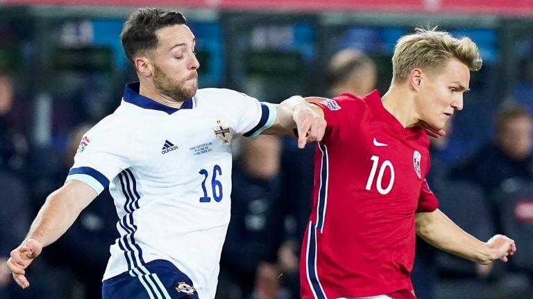 Northern Ireland forward Connor Washington (L) and Norway midfielder Martin Odegard