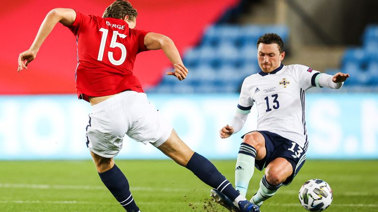 Corey Evans slides to knock out Sander Berg in the Nations League clash