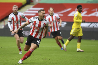 Billy Sharp of Sheffield United scored the opening goal from a penalty spot against Fulham at Bramal Lane on Sunday.
