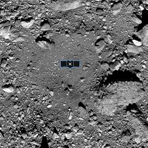 Osiris-Rex spacecraft's primary sample collection site, named Nightingale, on the asteroid Benu (via NASA / Goddard / AP, University of Arizona)