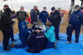 The trio, who had been on the space station for six months, return safely to Earth