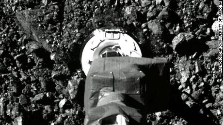 New images show the historic landing of NASA's spacecraft and sample collection from the asteroid