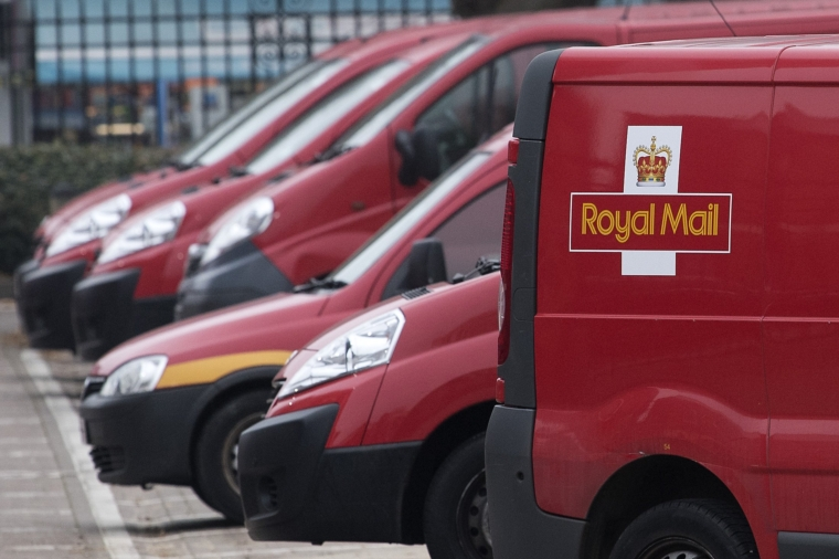 (Files) In this file photo taken on December 19, 2016, Royal Mail delivery vans are parked at the Mount Pleasant sorting office in London.  - Royal Mail, the British postal operator that has been delivering mail for over 500 years, announced plans on October 21, 2020 to collect parcels from UK homes in the wake of the epidemic.  (Justin Talis / AFP Photo) (Justin Talis / AFP Photo by Getty Images)