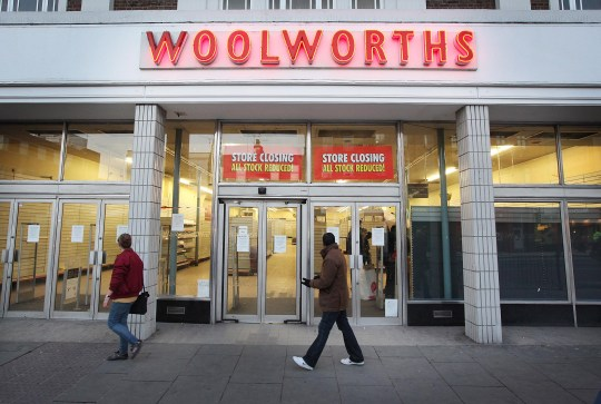 Shoppers walk past Camden Branch, which closed in January 2009 at Woolworths