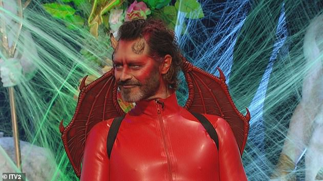 Devilish handsome: Howard Donald, 52, flung himself at the red PVC mesh and wings, prosthetic facial horns, no doubt he was a devil.