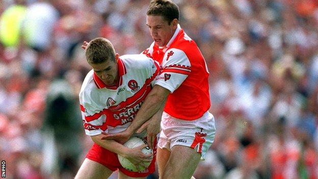 Current Armag manager Kieran McGinney fights Derry's Joe Cassidy in the 2000 Ulster Football Final