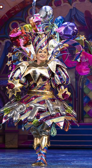 Showman Michael Harrison told me specifically, 'We all need a laugh at the end of the year', and he signed up to a cavalry of stars led by Julian Clary (pictured above at The Man in the Mirror London Palladium).