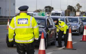 Guardoy at a checkpoint on the M7 motorway on the border of Dublin and Kildare on the first day of the Level 5 restrictions in Dublin.
