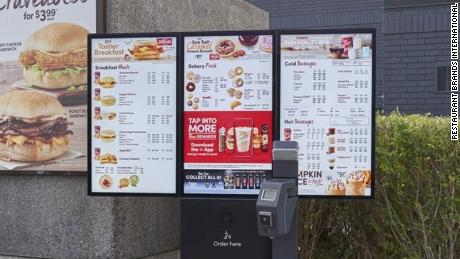 A Tim Hortons digital menu boards with loyalty program integration and contactless payment.